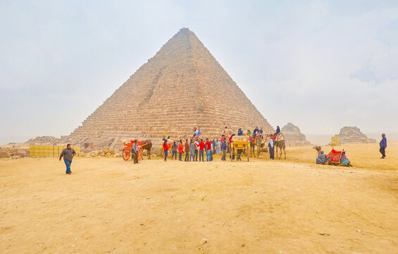 The tourists in the most famous Egyptian Necropolis, Giza