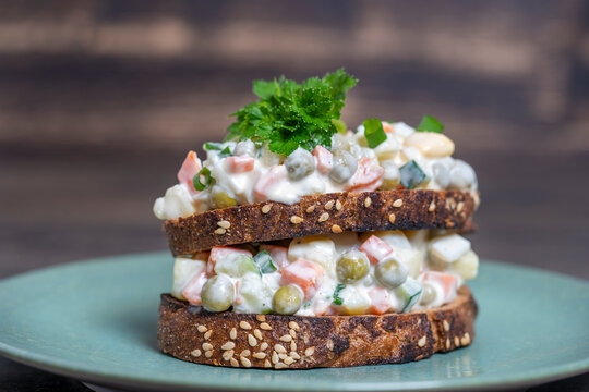 Healthy homemade double sandwich with olivier salad in plate, ready to eat. Ukrainian food