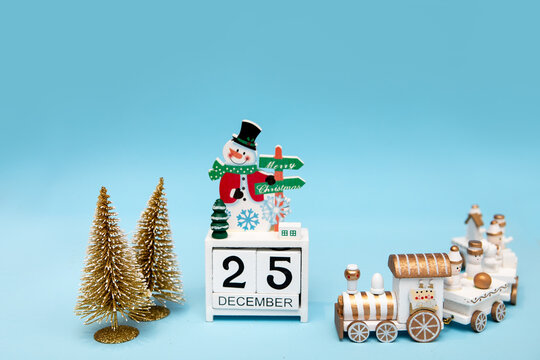 Christmas decorations and perpetual calendar on a light blue background. Christmas holiday concept