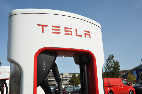 Bispingen / Germany - September 17, 2020: Tesla Supercharger Station near Bispingen, Germany - Tesla is an American electic vehicle and clean energy company