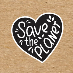Fototapeta Save the planet - hand written sing with heart simbol on kraft paper. Vector stock illustration isolated on chalkboard background for print on T-shirt, sticker, banner. obraz