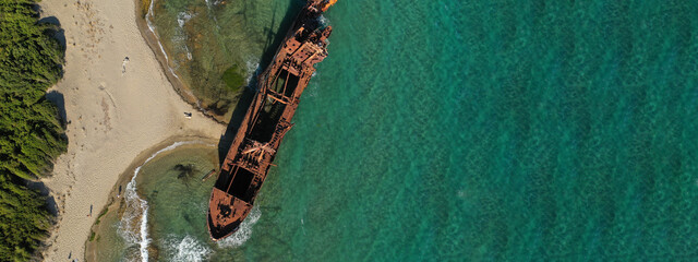 Aerial drone ultra wide photo of famous abandoned old rusty shipwreck of Dimitrios in Selinitsa bay Githeio, Peloponnese, Laconia, Greece