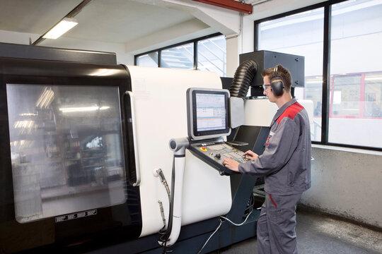 Stonemason working with CNC machine in his workshop