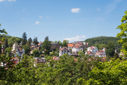 Germany, Thuringia, Eisenach, Historical villas surrounded by green forested hills in spring
