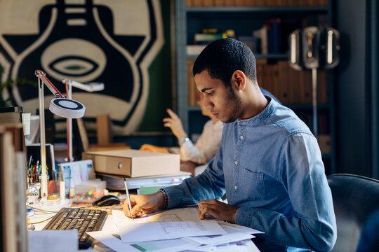 Young man working in architect's office