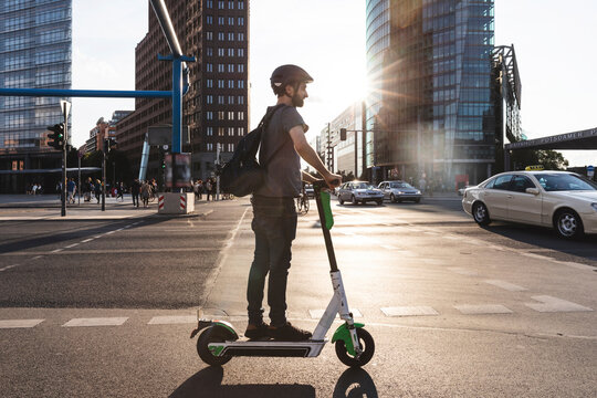 Man using e-scooter in Berlin, Germany