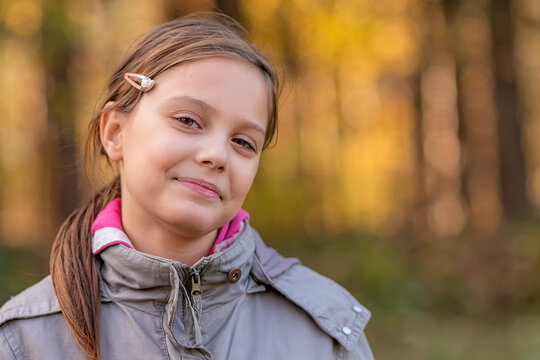 Portrait of a girl in the woods with a beautiful bokeh.