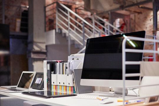 PC monitor on desk in modern office