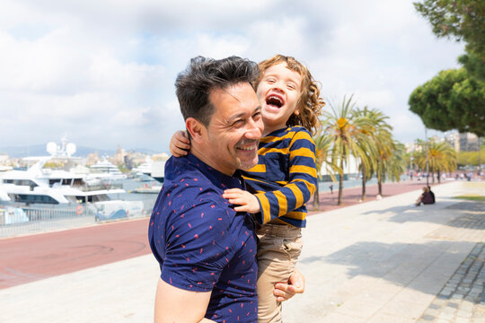 Spain, Barcelona, father and son playing together and having fun