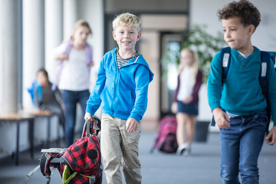 Schoolboy with classmates leaving school