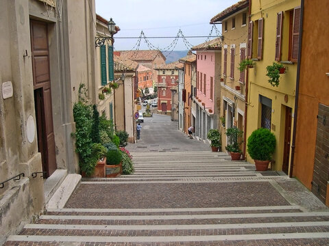Italy, Marche, Mondolfo, downtown medieval street and steps.