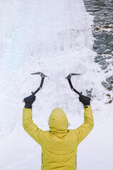 Man with ice axe for ice climbing