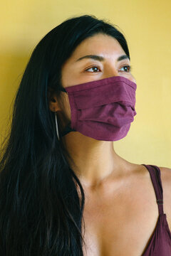 Asianl girl in a protective mask from textiles.