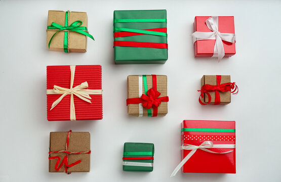Flat lay composition with Christmas gift boxes on light background