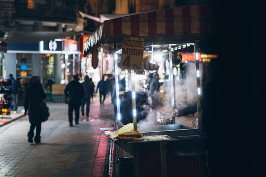 Vendor selling food on street in downtown at night