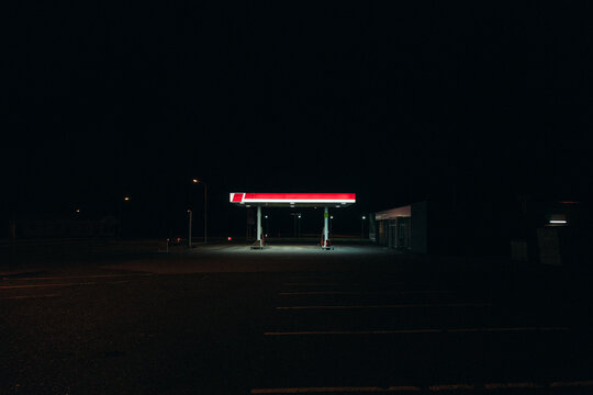 Bright gas station glowing in darkness of night