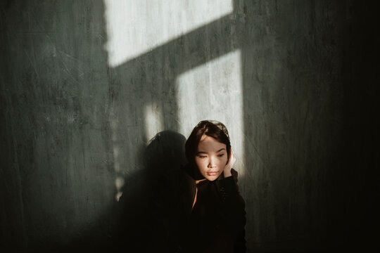 Asian girl in a dark room.