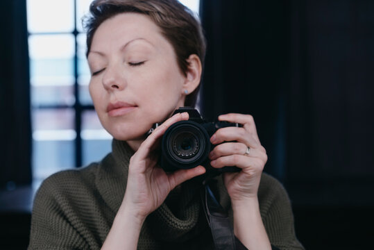Female photographer with a camera.