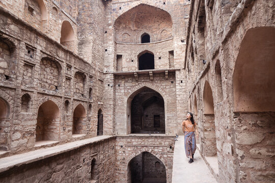 Ethnic tourist in historical step well