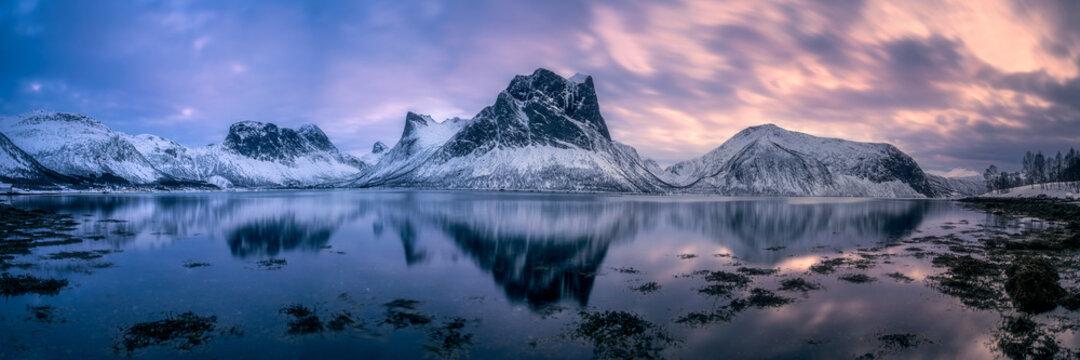 Mirror-like reflection of norwegian mountain range