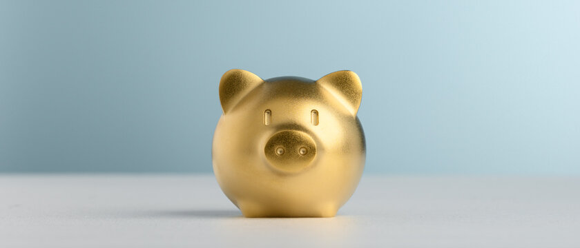 Golden Piggy Bank with blue background for saving and invest concept.