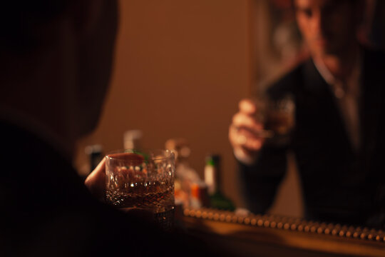 Young man drinking fine whisky