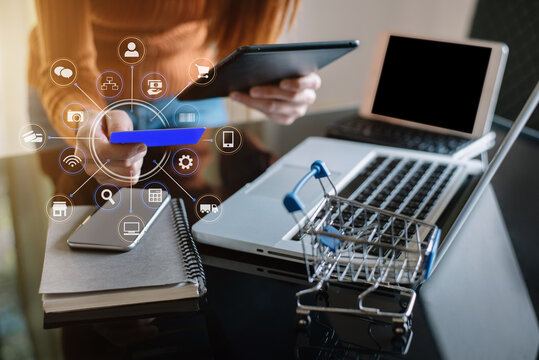 Woman hand holding laptop, tablet and using credit card for online shopping.Online shopping concept.