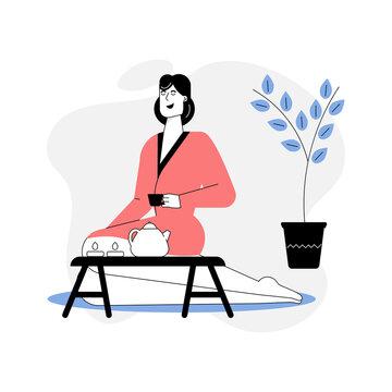 Woman in bathrobe relaxing in spa salon, drinking tea