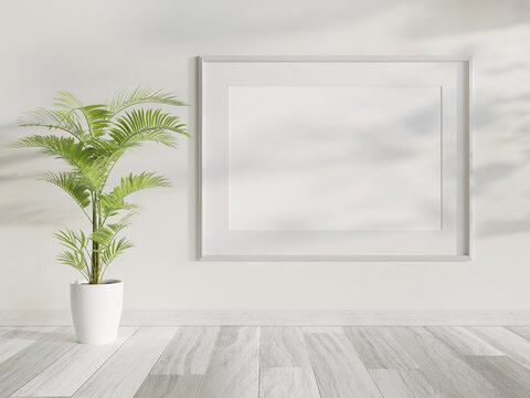White frame hanging in bright interior mockup. Template of a picture framed on a wall 3D rendering