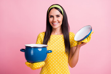 Photo of brown haired young woman positive housemaid hold pan glove isolated on pastel vivid pink color background Wall mural