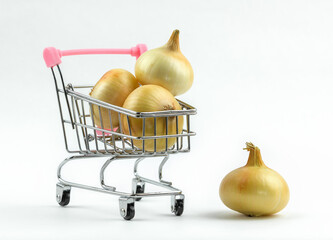 Grocery shopping cart with organic onions. Isolated on white.