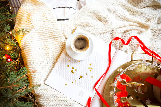 Coffee cup on book during Christmas holiday