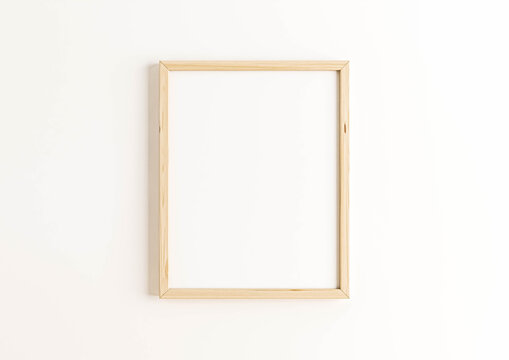 Vertical 8x10 Wood Frame Mockup. Vertical Wood Frame on a white wall.
