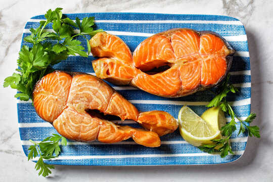 salmon steaks on a blue plate, top view
