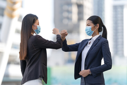 Business people in facial covers protect from COVID-19 coronavirus