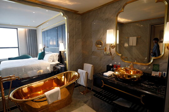 A gold-plated bathtub and bathroom sink are seen in the Dolce Hanoi Golden Lake luxury hotel in Hanoi