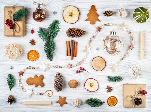 Christmas set collection, background with decorations. Christmas gift, pine cones, fir branches, gingerbreads on white wooden background. Concept on Christmas topic. Retro style.