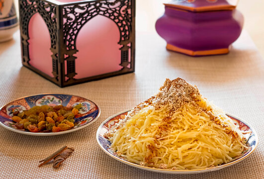 Moroccan Seffa with Angel Hair Pasta Sweetened with Sugar, Cinnamon and Almonds, presented on Traditional Decorated Dishes.