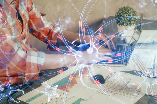 Neuron hologram with man working on computer on background. Education concept. Double exposure.