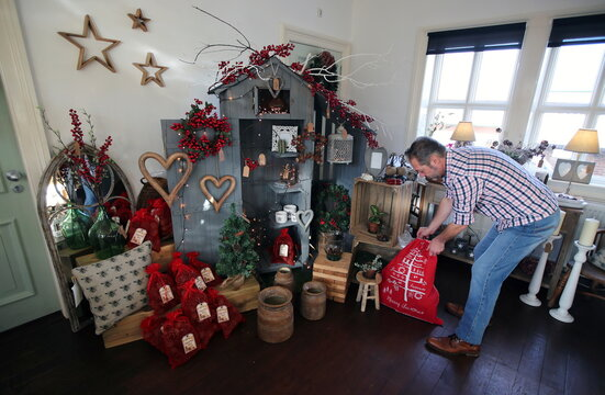 Ade, owner of Me and Mr Jones Gift Shop, prepares his shop for Christmas and reopening after lockdown, amid the coronavirus disease (COVID-19) outbreak, in Frodsham