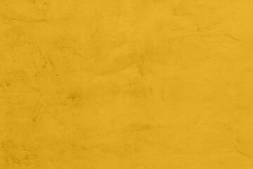 Saturated yellow colored low contrast Concrete textured background with roughness and irregularities. 2021 color trend.