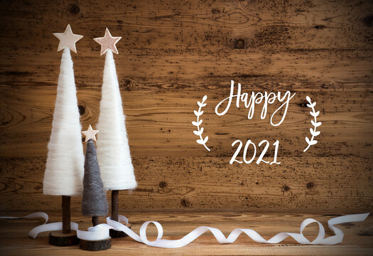 Christmas Decoration Like White Tree With Star On Wooden Background. White Ribbon For Festive Ornament. English Calligraphy Happy 2021