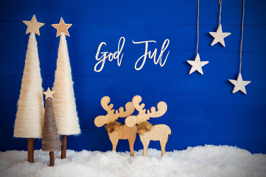 Swedish Calligraphy God Jul Means Merry Christmas On Blue Background With Snow. Decoration Like Crhistmas Trees, Moose And Stars.