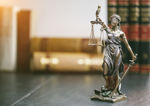 Close-up Of Lady Justice On Table