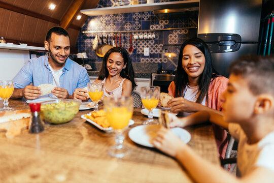 Latin family having dinner at home