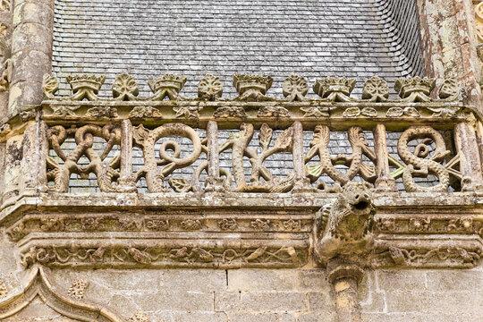 Josselin, France. Decorative stone carving on the castle facade and gargoyle