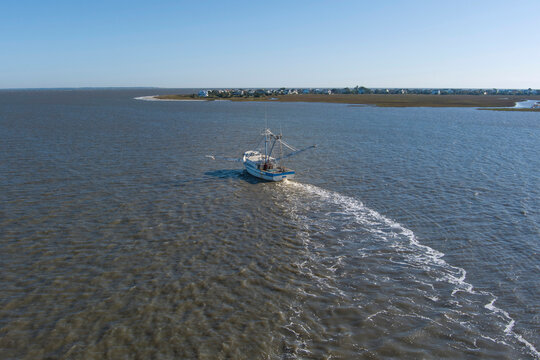A shrimp boat pulls nets off the coast of South Carolina in this aerial view.