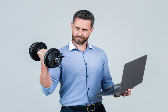 Online work gym that helps spur productivity. Manager hold laptop curling dumbell. Strength training. Business coach. Fitness at work. Weightlifting workout. Workplace gym. Technology in sport
