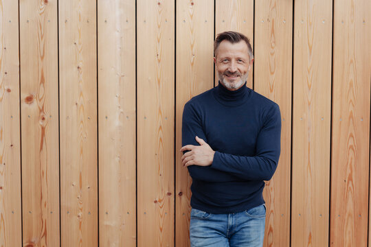 Confident smiling man with folded arms