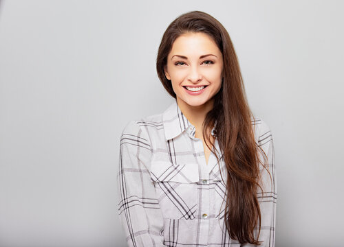 Beautiful smiling positive successful business woman in looking confidently in white shirt and long hair. Closeup portrait